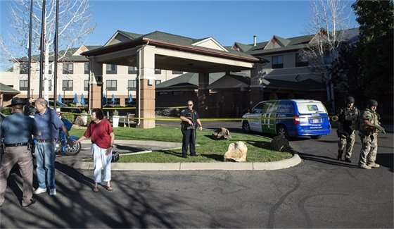 DA: Police Officer Acted In Self-Defense In Hotel Standoff